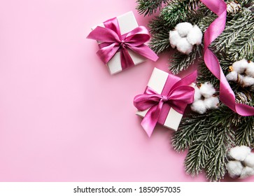 Christmas composition. Christmas gifts, pink decorations on pastel pink background. Flat lay, top view, copy space