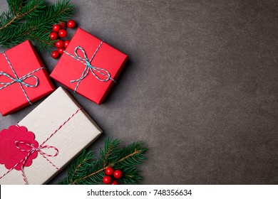 Christmas composition. Christmas gifts, christmas tree, decorations on dark background. Flat lay, top view. Copy space