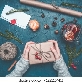 Christmas composition, a girl holds a gift, toys and New Year attributes are laid out, a place for text