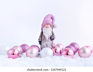 Christmas composition with gnome and festive decorations on a white background. New Year greeting card.