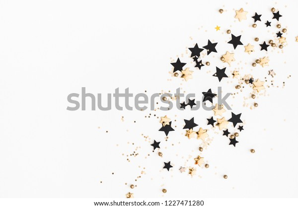 Christmas composition. Christmas golden and black decorations on white background. Flat lay, top view, copy space