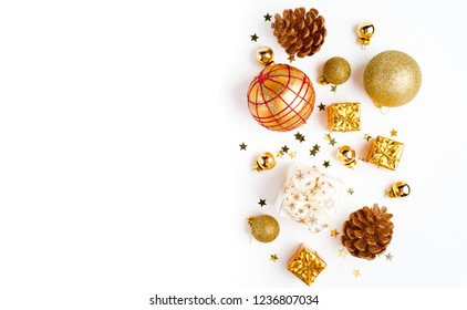 Christmas composition. Christmas golden decor, pine cone, star on white background. Flat lay, top view, copy space