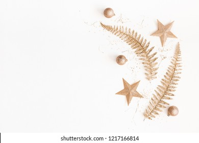 Christmas composition. Christmas golden decorations on white background. Flat lay, top view, copy space
