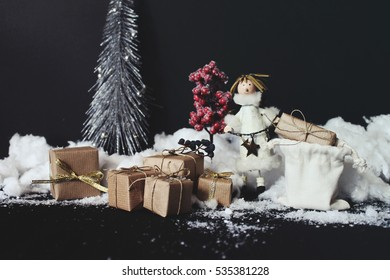 Christmas composition. Landscape with christmas tree, presents and snow, black background