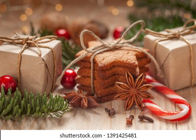 Christmas - a composition made of homemade gingerbreads, nuts, anise, cinnamon sticks, goats, dried oranges, green fir, bells and gifts