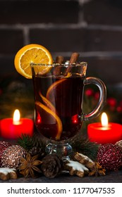 Christmas composition with mulled wine and candles, closeup