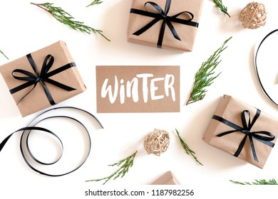 Christmas composition on a white background with card with handwritten quote - Winter