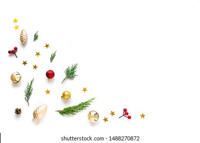 Christmas composition. Christmas ornaments, pine cones, fir branches, golden stars on isolated on white background. Flat lay, top view, copy space.