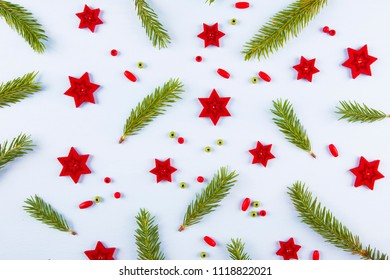 Christmas composition. Pattern made of christmas tree branches  and red stars