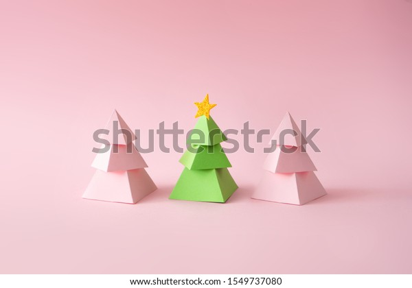 Christmas composition. Pink and green Christmas trees on pink background. Happy holidays. new year minimal concept.