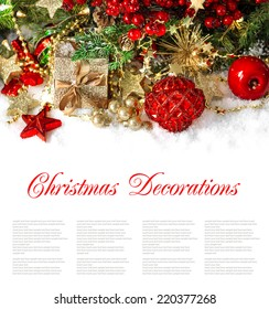 christmas composition with red baubles, golden decorations, gifts, pine and berries branches. festive arrangement wit sample text