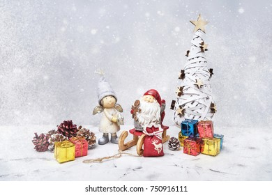 Christmas composition with Santa and small gifts. Copy space