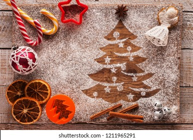 Christmas composition with seasonal sweets ingredients and xmas tree in flour
