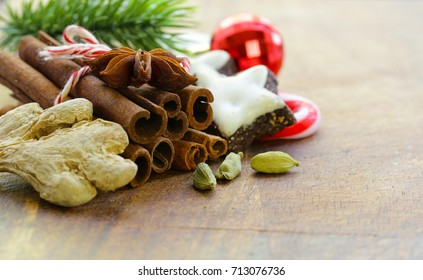 Christmas composition, spices and cookies on a wooden background