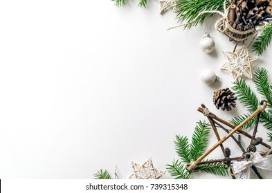 Christmas composition with spruce branches and New Year's accessories and decorations. Preparing for Christmas. Background for the demonstration of works or text. View from above. Copy space