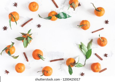 Christmas composition. Tangerines, cinnamon sticks, anise stars on white background. Christmas, winter concept. Flat lay, top view, copy space