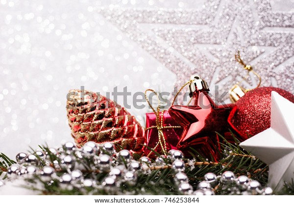 Christmas composition of Christmas tree toys on a silver background.