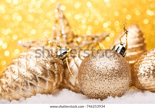 Christmas composition of Christmas tree toys on a gold background.