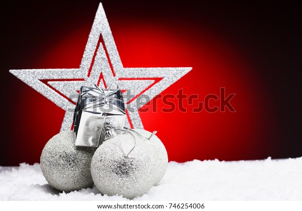 Christmas composition of Christmas tree toys on a red background.