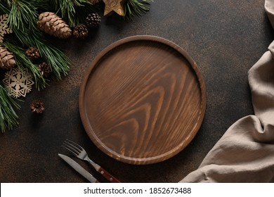 Christmas composition of wooden tray for holiday homemade dish on brown cozy home table with natural decoration. Top view. - Shutterstock ID 1852673488