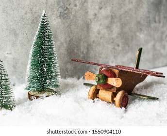 Christmas composition with a wooden vintage airplane  and Christmas tree in snow