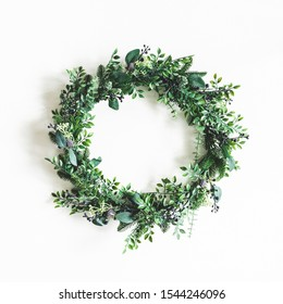 Christmas composition. Christmas wreath on white background. Flat lay, top view