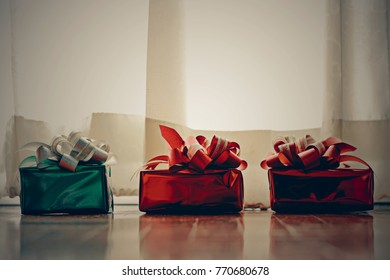Christmas concept background with decorations and gift boxes on wooden boards with copy space, Image Style Vintage and Film Tone.