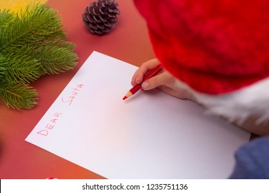 Christmas concept. Boy writing letter to Santa. Top view, flat lay. Childhood.
