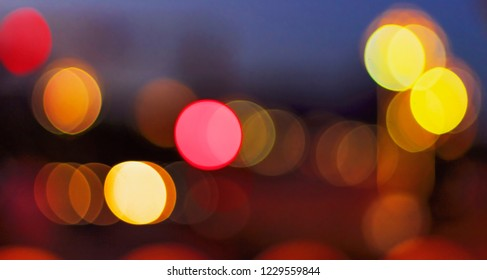 Christmas concept: Festive background with light spots and bokeh in front of a empty wooden table
