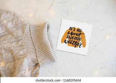 Christmas concept flat lay. Warm, cozy winter clothing and Christmas decorations frame on white background