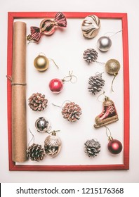 Christmas concept, greeting card, gift box, Christmas toys and cones, on a white background, frame flat lay