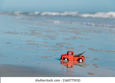 Christmas concept. Christmas pickup truck stuck in the sand on New Smyrna Beach Florida.
