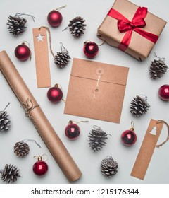 Christmas concept, postcard, gift box, Christmas toys and cones, on a white background, flat lay