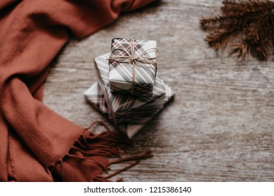 Christmas concept. Presents on the wooden table,  scarf and spruce branch. Top  view image