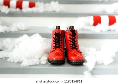 Christmas concept with red shoes. Santa's shoes