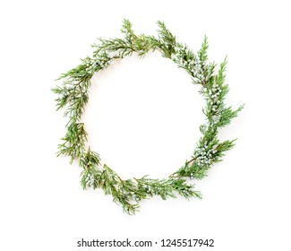 Christmas concept. Round frame made of winter evergreen plants. Flat lay, top view