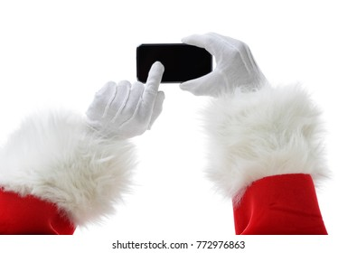 Christmas concept shot with Santa holding a black smart phone, showing it into the camera.Isolated on white