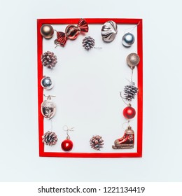 Christmas concept, Christmas tree twigs and Christmas tree cones on a white background, frame, place for text