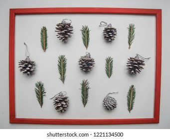 Christmas concept, Christmas tree twigs and Christmas tree cones on a white background flat lay