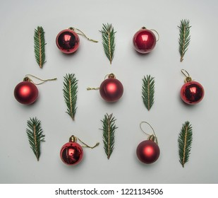 Christmas concept, tree twigs and Christmas decorations on a white background flat lay