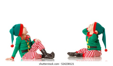 Christmas concept two children cheerful elf looking up isolated on white background