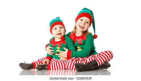 Christmas concept two children cheerful elf looking up isolated on white  background 5fc17b042
