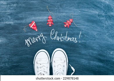 Christmas concept with white shoes and white chalk