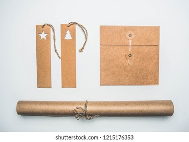 Christmas concept, wrapping paper, envelope and tags on white background flat lay