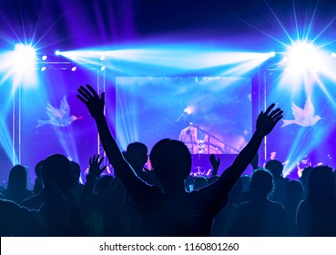 Christmas concept:Christian worship with raised hand and pray in the worship concert