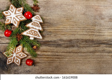 Christmas cookies and apples on wooden background. Copy space, blank board for your text