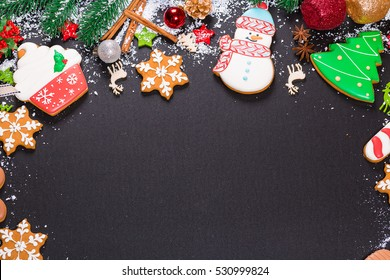 Christmas cookies with candy, cone and fir festive decoration with snow. View with copy space