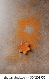 Christmas cookies with cinnamon. Light gray background.