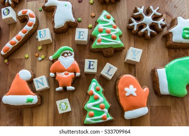 Christmas cookies decorated  with colored icing on the wooden background.