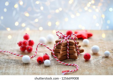 Christmas cookies with christmas decorations against the background of festive lights. Christmas or New Year greeting card.